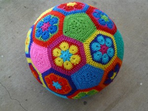 http://www.crochetbug.com/how-to-make-an-african-flower-soccer-ball/